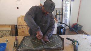 Master Glazier, Jeffrey Cruse restoring stained glass